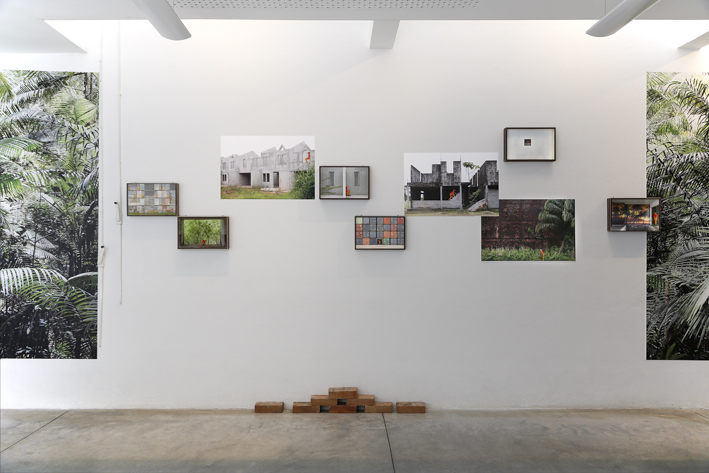 Exhibition view - Ibiscube - House of architecture french Guiana - Biennial Les Rencontres photographiques - Pigment prints on enthomologic box and vinyl, red bricks